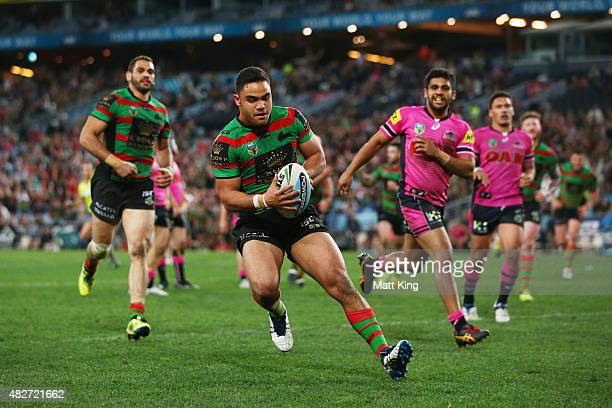 Dylan Walker of the Rabbitohs scores a try during the round 21 NRL match between the South Sydney Rabbitohs and the Penrith Panthers at ANZ Stadium...