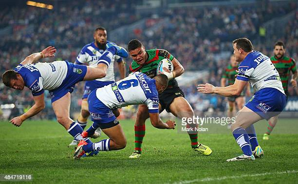 Dylan Walker of the Rabbitohs tries to break the bulldogs defence during the round 24 NRL match between the South Sydney Rabbitohs and the Canterbury...