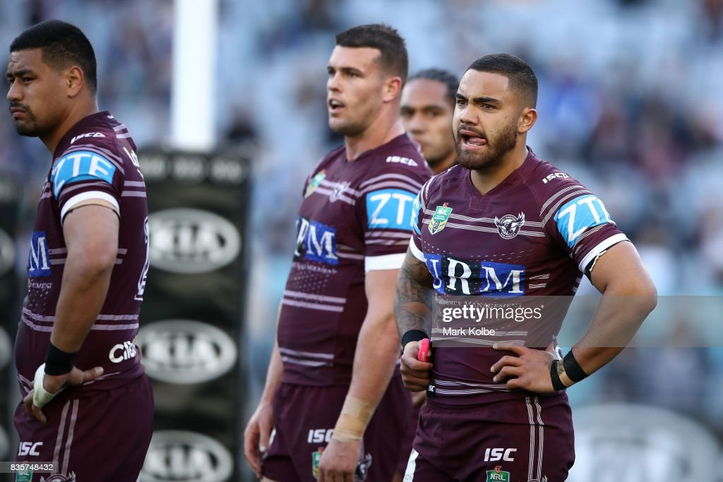 Dylan Walker of the Sea Eagles and his team mates look dejected after a Bulldogs during the round 24 NRL match between the Canterbury Bulldogs and the Manly Sea Eagles at ANZ Stadium on August 20, 2017 in Sydney, Australia.