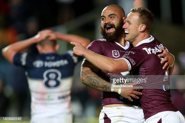 Dylan Walker of the Sea Eagles celebrates scoring a try with team mate Daly Cherry-Evans of the Sea Eagle during the round 14 NRL match between the...