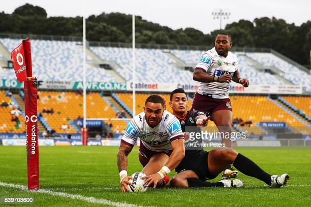 Dylan Walker of the Sea Eagles dives over to score a try during the round 25 NRL match between the New Zealand Warriors and the Manly Sea Eagles at...
