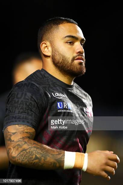 Konrad Hurrell of the Titans is tackled during the round 23 NRL match between the Manly Sea Eagles and the Gold Coast Titans at Lottoland on August...