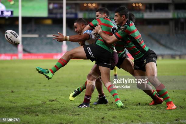 Dylan Walker of the Sea Eagles gets a pass away as he is tackled by Cody Walker and Bryson Goodwin of the Rabbitohs during the round nine NRL match...