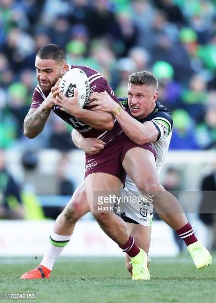 Dylan Walker of the Sea Eagles is tackled by Jack Wighton of the Raiders during the round 23 NRL match between the Canberra Raiders and the Manly Sea...