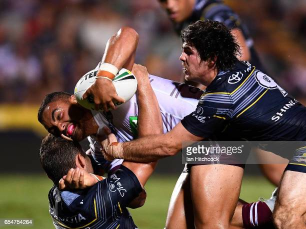 Dylan Walker of the Sea Eagles is tackled by Jake Granville and Benjamin Hampton of the Cowboys during the round three NRL match between the North...