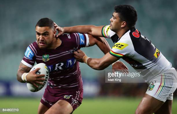Dylan Walker of the Sea Eagles is tackled by Tyrone Peachey of the Panthers during the NRL Elimination Final match between the Manly Sea Eagles and...