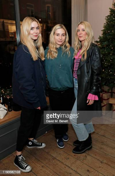Dylan Weller Chelsea Williams and Gracie Egan attend the PAIGE x DryBy Christmas Party on December 12 2019 in London England