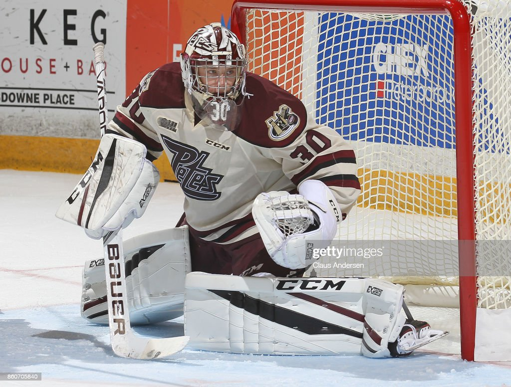 Dylan Wells #30 of the Peterborough Petes watches for a shot against the Kingston Frontenacs in an OHL game at the Peterborough Memorial Centre on October 12, 2017 in Peterborough, Ontario.