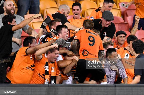 Dylan WenzelHalls and Adam Taggart of the Roar celebrate a goal with fans during the round 18 ALeague match between the Brisbane Roar and Sydney FC...