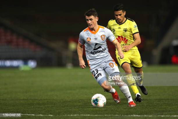 Dylan WenzelHalls of Brisbane Roar contests the ball with Ulises Davila of Wellington Phoenix during the round 28 ALeague match between the...