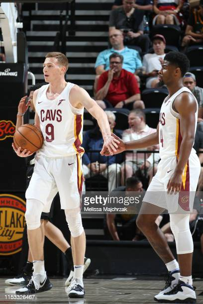 Dylan Windler highfives Malik Newman of the Cleveland Cavaliers against the San Antonio Spurs on July 1 2019 at vivintSmartHome Arena in Salt Lake...