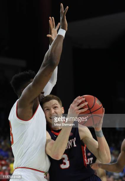 Dylan Windler of the Belmont Bruins dribbles the ball against Bruno Fernando of the Maryland Terrapins in the second half during the first round of...