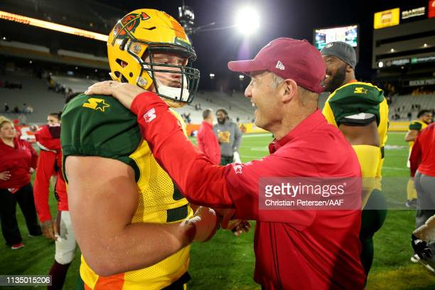 Dylan Wynn of the Arizona Hotshots and head coach Mike Riley of the San Antonio Commanders shake hands after the San Antonio Commanders beat the...