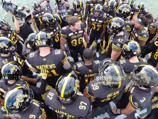 Dylan Wynn of the Hamilton Tiger-Cats addresses the tema before kickoff against the Winnipeg Blue Bombers at Tim Hortons Field on July 26, 2019 in...