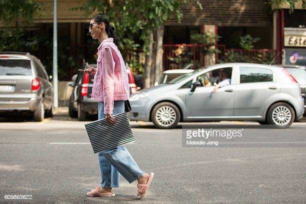 Dylan Xue is seen wearing a pink denim jacket blue jeans and pink furry Puma sandals during Milan Fashion Week Spring/Summer 2017 on September 22...