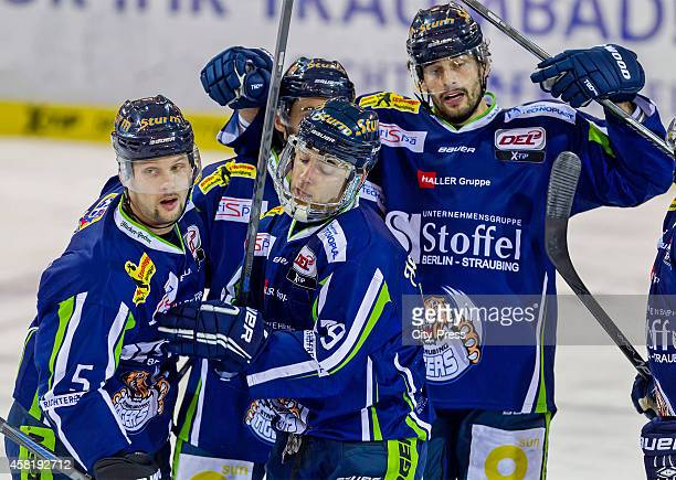 Dylan Yeo, Blaine Down and Florian Ondruschka of the Straubing Tigers celebrate after scoring the 3:1 during the game between Straubing Tigers and...