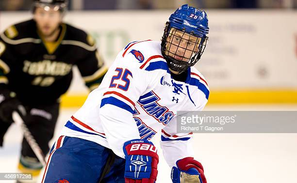 Dylan Zink of the Massachusetts Lowell River Hawks skates against the St. Thomas University Tommies during NCAA exhibition hockey at the Tsongas...