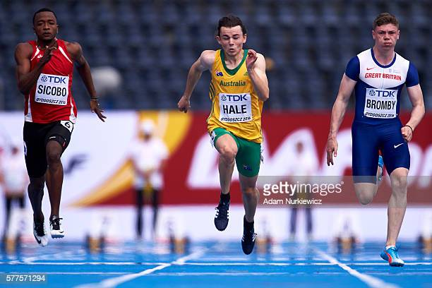 Dyland Sicobo from Seychelles and Jack Hale from Australia and Oliver Bromby from Great Britain compete in men's 100 meters qualification during the...