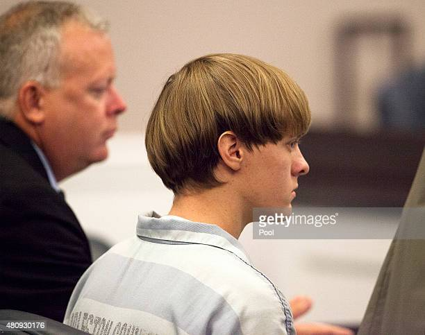 Dylann Roof listens to proceeding with assistant defense attorney William Maguire during a hearing at the Judicial Center July 16 2015 in Charleston...