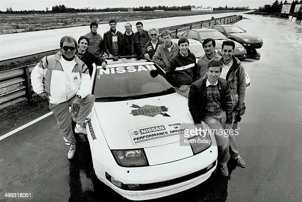 Dynamic Dozen The 12 finalists in the 1991 Wheels/Bridgestone Challenge pose with a Nissan 300ZX at Shannonville Motorsport Park Clockwise from left...
