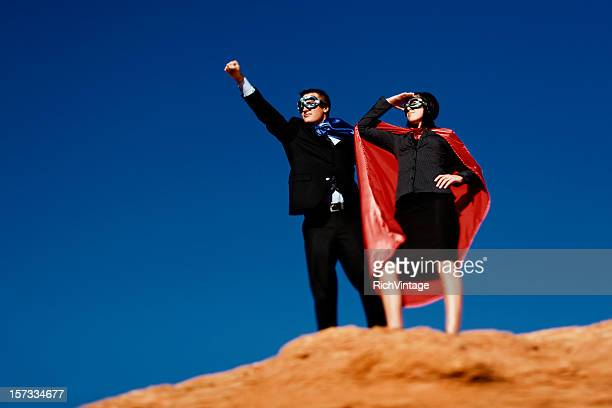 dynamic duo - cape garment stock photos and pictures
