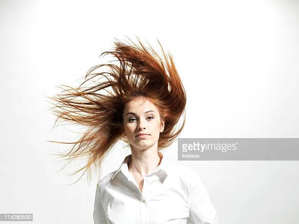 dynamic women's hair - windswept stock pictures, royalty-free photos & images
