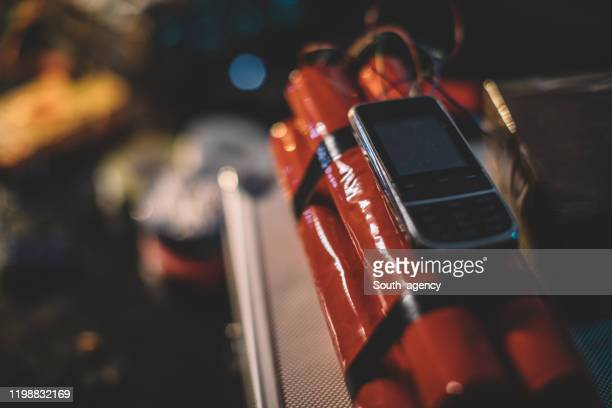 dynamite bomb with mobile phone attached to it - terrorism stock pictures, royalty-free photos & images