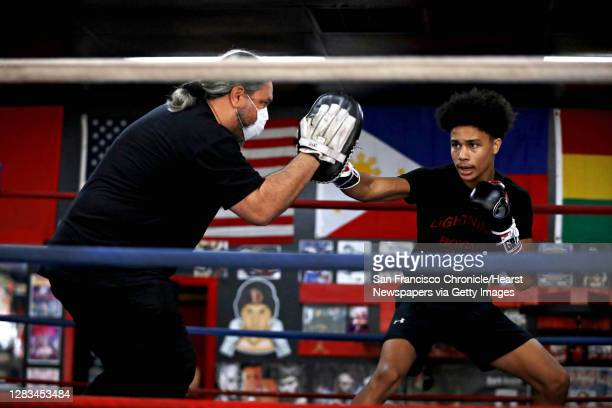 """Dynamite David Lopez receives coaching from his dad, Kris """"Lightning"""" Lopez, in the ring at the Lightning Boxing Club on Tuesday, October 20 in..."""
