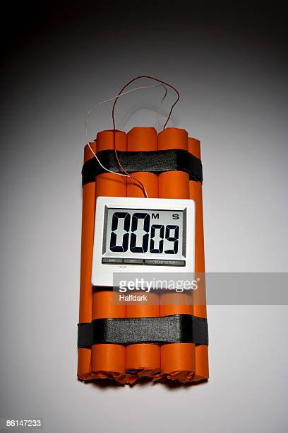 a dynamite time bomb with 9 seconds left on the timer - time bomb stock photos and pictures