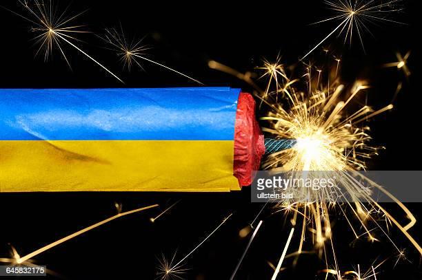Dynamitstange mit Ukraine-Fahne, Symbolfoto Ukraine-Konflikt