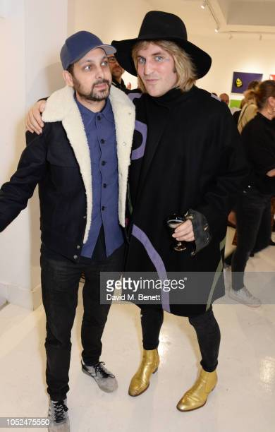 Dynamo and Noel Fielding attend a private view of Daft Apeth by Serge Pizzorno of Kasabian at No Ho Showrooms on October 18 2018 in London England