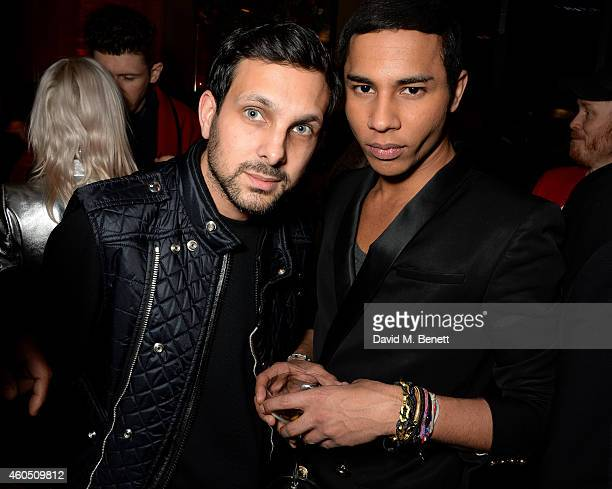 Dynamo and Olivier Rousteing attend the LOVE x Balmain Xmas Party at The Ivy Market Grill on December 15 2014 in London England