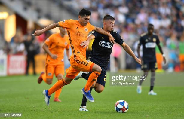 Dynamo Defender Jose Bizama carries the ball past Union Defender Kai Wagner in the second half during the game between the Houston Dynamo and...
