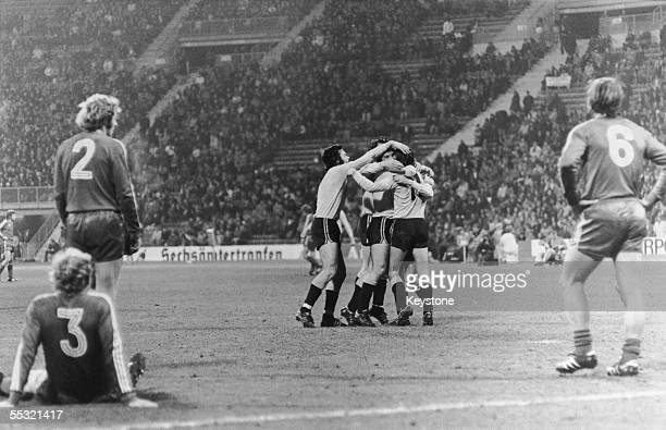 Dynamo Dresden players celebrate after their first goal against Bayern Munich in the second round first leg of the European Cup at the Munich Olympic...