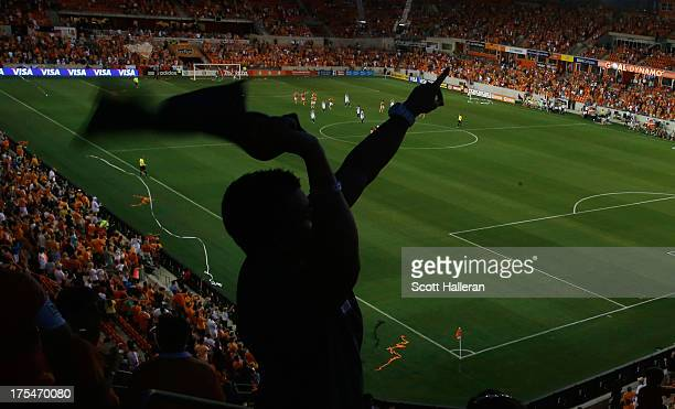 Dynamo fan celebrates after Brad Davis of the Houston Dynamo scored a first half goal against the Columbus Crew at BBVA Compass Stadium on August 3,...