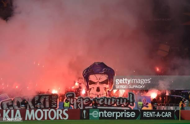 Dynamo fans react during the UEFA Europa League round of 32, second leg football match between FC Dynamo Kyiv and Olympiacos FC at Olympiyski Stadium...