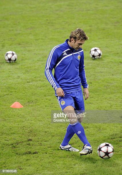 Dynamo Kiev forward Andriy Shevchenko plays with a ball as he attends a training session at San Siro stadium in Milan on October 19 2009 on the eve...