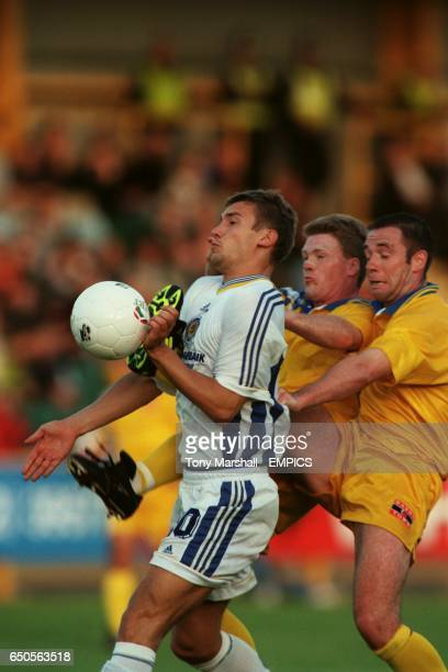 Dynamo Kiev's Andriy Shevchenko tries to control the ball under pressure from Barry Town's Lee Barrow and Gary Lloyd