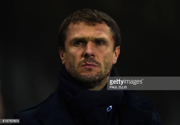 Dynamo Kiev's coach Serguey Rebrov watches during a UEFA Champions League last 16 second leg football match between Manchester City and Dynamo Kiev...
