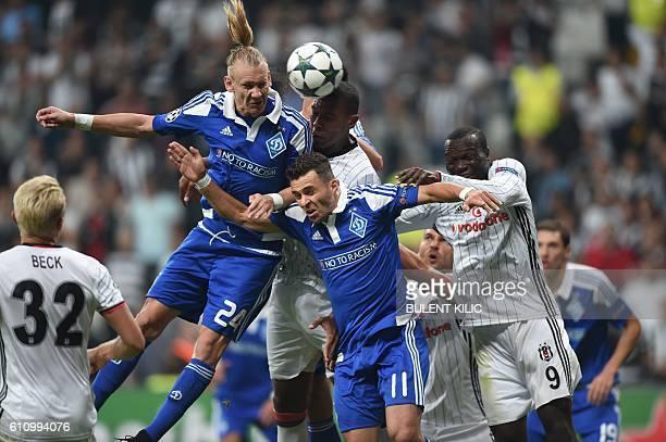 Dynamo Kiev's Croatian defender Domagoj Vida and Brazilian forward Junior Moraes head the ball with Besiktas' Cameroonian forward Vincent Aboubakar...