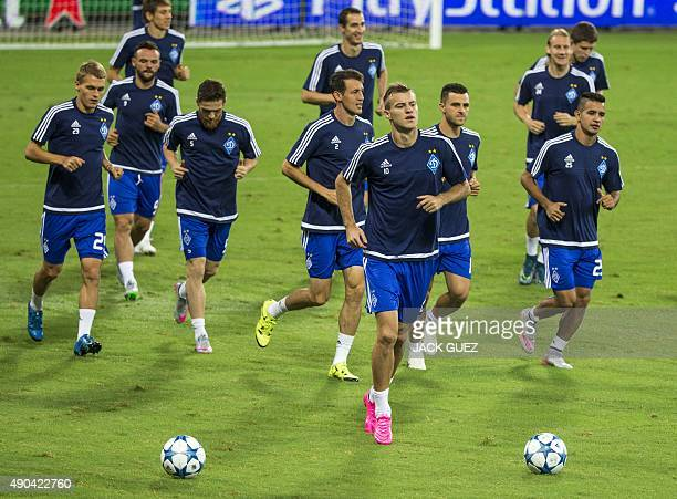 Dynamo Kievs football players take part in a training session at the Sammy Ofer Stadium in the Israeli coastal city of Haifa on September 28, 2015 on...