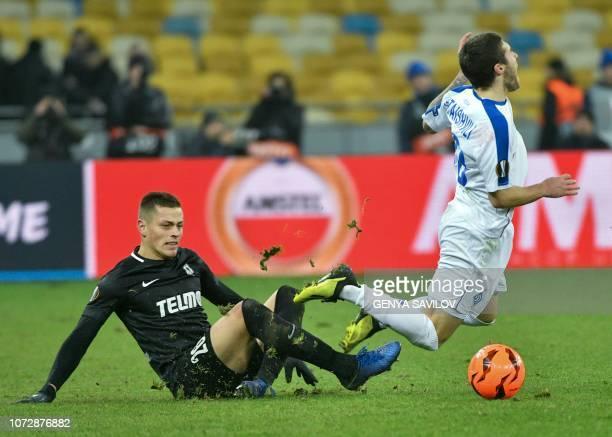 Dynamo Kiev's Heorhii Tsitaishvili and Jablonec's Tomas Holes vie for a ball during the UEFA Europa League Group K football match between Dynamo Kiev...