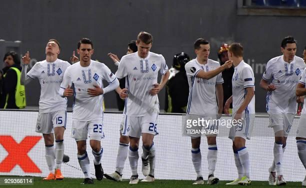 Dynamo Kiev's midfielder from Ukraine Viktor Tsygankov celebrates with teammates after scoring during the UEFA Europa League round 16 firstleg...