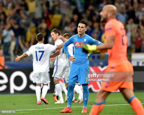 FC Dynamo Kiev's players celebrate after scoring a goal during the UEFA Champions League football match between FC Dynamo Kiev and SSC Napoli at the...