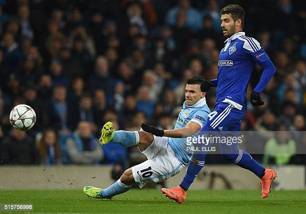 Dynamo Kiev's Portuguese midfielder Miguel Veloso vies with Manchester City's Argentinian striker Sergio Aguero as he attempts a shot on goal during...
