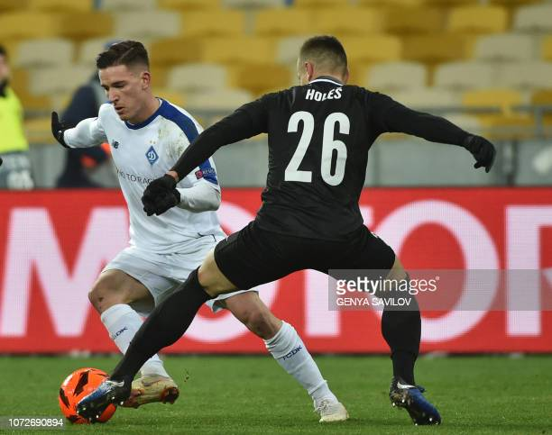 Dynamo Kiev's Slovenian midfielder Benjamin Verbic and Jablonec's Czech defender Tomas Holes vie for the ball during the UEFA Europa League Group K...