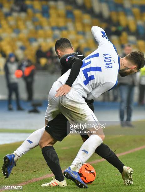 Dynamo Kiev's Tamas Kadar and Jablonec's Rafael Acosta vie for a ball during the UEFA Europa League Group K football match between Dynamo Kyiv and...