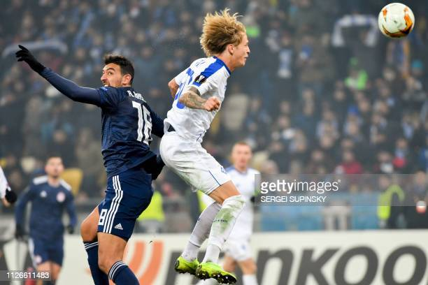 Dynamo Kiev's Ukrainian defender Artem Shabanov and Olympiakos' Egyptian forward Ahmed Hassan jump for the ball during the UEFA Europa League round...