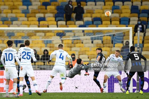 Dynamo Kiev's Ukrainian goalkeeper Heorhiy Bushchan in action against Club Brugge's Uruguayan defender Federico Ricca vie for the ball during the...