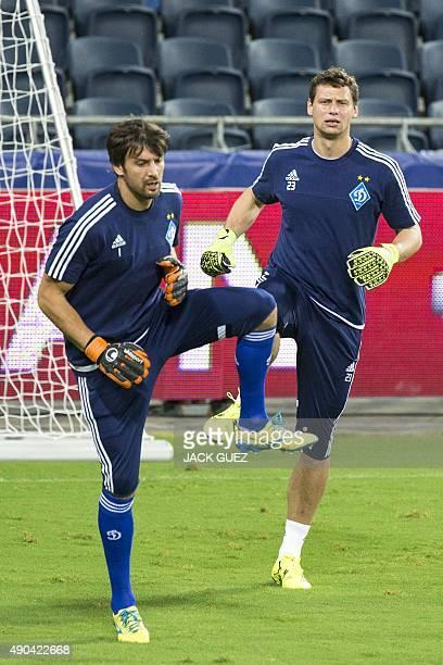 Dynamo Kievs Ukrainian goalkeepers Olexandr Shovkovskiy and Olexandr Rybka take part in a training session at the Sammy Ofer Stadium in the Israeli...